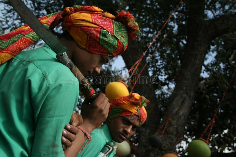 Indian Tribal Dancers in their traditional costumes with weapons. Indian Tribal Dancers performing near Gandhi hall Indore during a tribal festival stock image