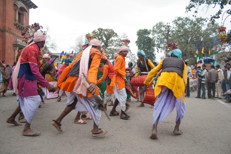 Indian Villagers and folk Dancers and musicians. Indian Tribal Dancers performing near Gandhi hall Indore during a tribal festival stock image