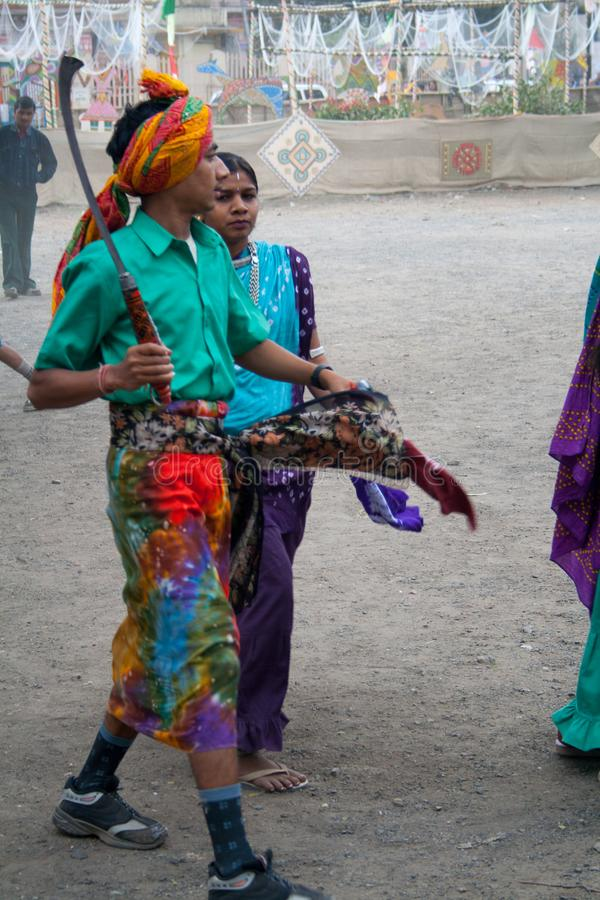 Indian Tribal Dancers in their traditional costumes with weapons. Indian Tribal Dancers performing near Gandhi hall Indore during a tribal festival stock photography