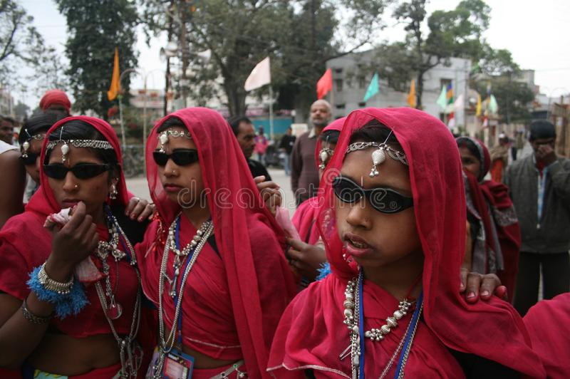 Indian Tribal Dancers in their traditional costumes with weapons. Indian Tribal Dancers performing near Gandhi hall Indore during a tribal festival stock photo
