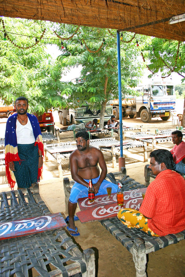 Indian truck drivers on the roadside of highways, Kerala. Indian truck drivers on the roadsides of highway, Kerala. Relaxing and having their food and drink royalty free stock photography