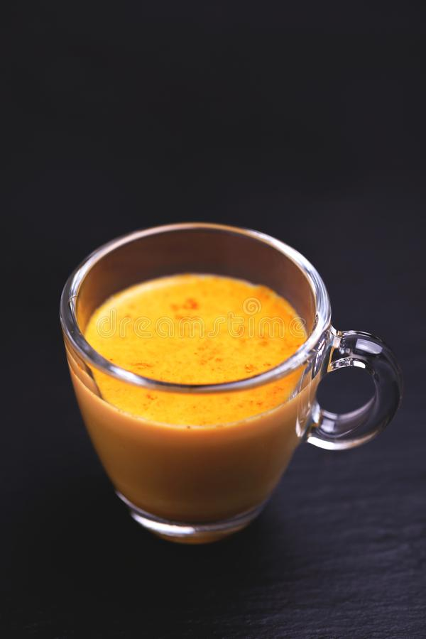 Indian turmeric milk with saffron, cardamom and turmeric. Copyspace. Traditional Indian cuisine. Turmeric milk with cinnamon, saffron, cardamom and turmeric on royalty free stock photos
