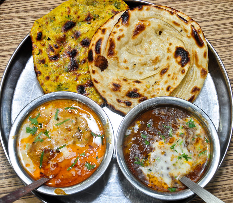 Indian Vegetarian meal. Indian vegeterian meal with Malai Kofta , Dal makhani and Tandoori Roti royalty free stock images