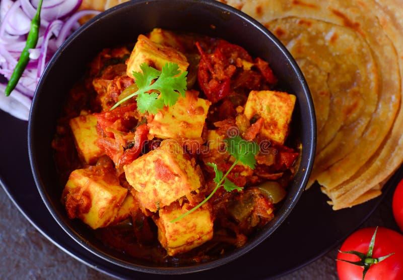Indian vegetarian meal-Kadai Paneer and lachcha paratha royalty free stock images