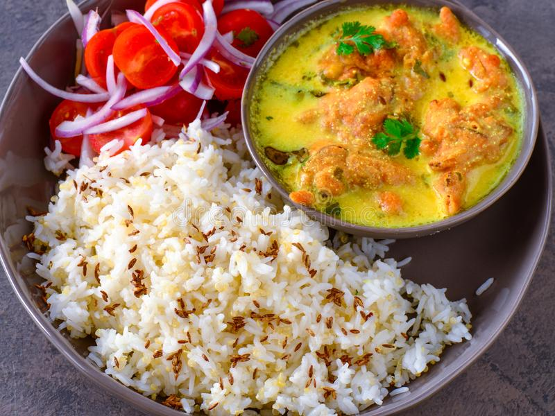 Indian vegetarian meal - punjabi kadi and rice stock images