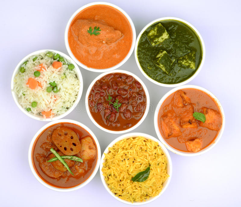 Indian Vegetarian meal top view. Indian vegeterian meal with Pulao, Palak Paneer, Gatte ki sabji, aloo curry,rajma and yellow rice royalty free stock photo