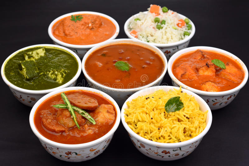 Indian Vegetarian meal. Indian vegeterian meal with Pulao, Palak Paneer, Gatte ki sabji, aloo curry,rajma and yellow rice stock images