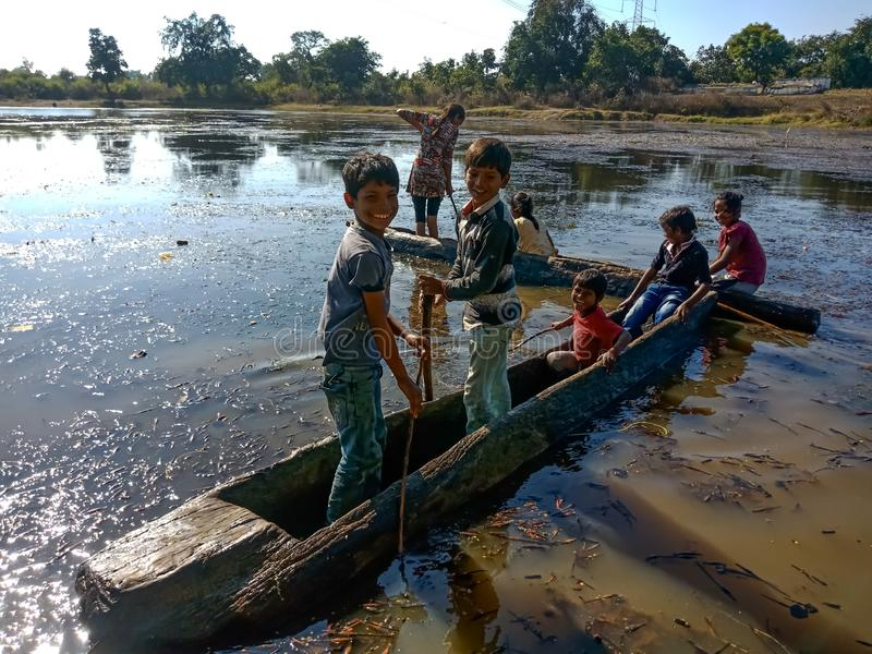 Indian village childrens riding boat into the water lake at forest area in india dec 2019 stock image