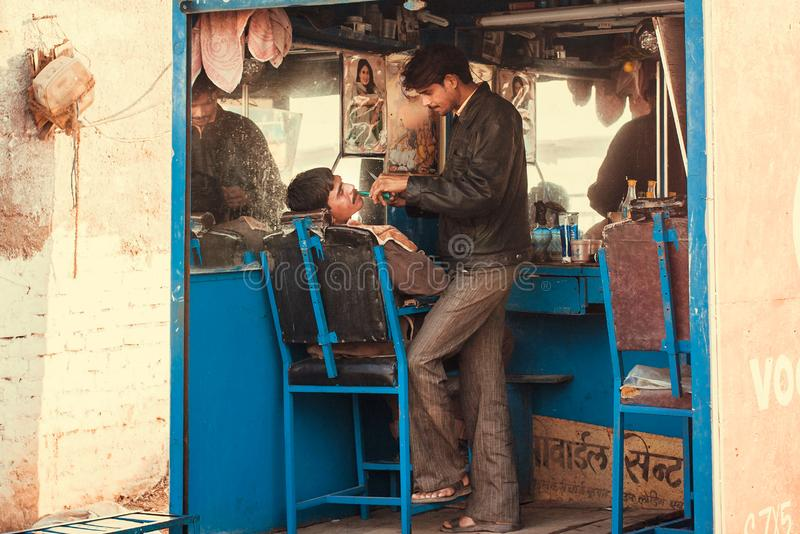Indian village professional hairdresser salon on street for poor people royalty free stock photo