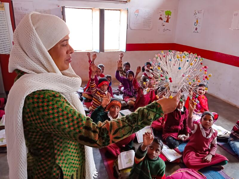Indian village school female teacher displayed decorative object into the classroom in india January 2020 royalty free stock photography