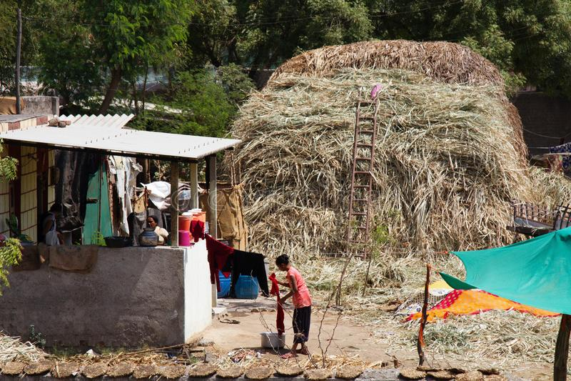 indian village yard with a haystack stock photography