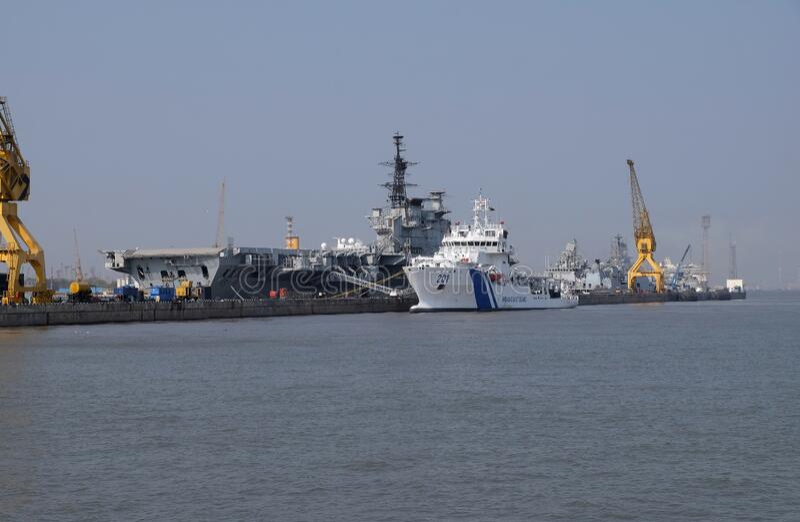 Indian Viraat aircraft carrier and Coast Guard ship anchored at a port in Mumbai. India stock photos