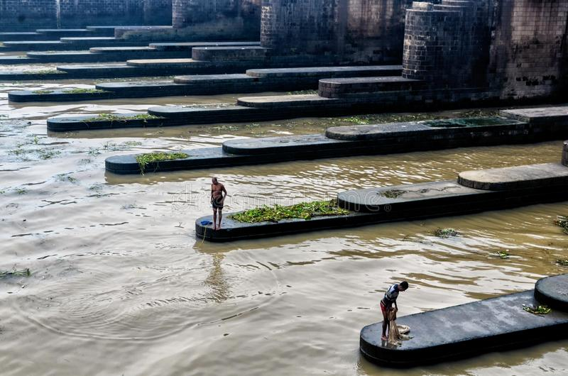 Indian washermen and fishers in the dams. royalty free stock photography