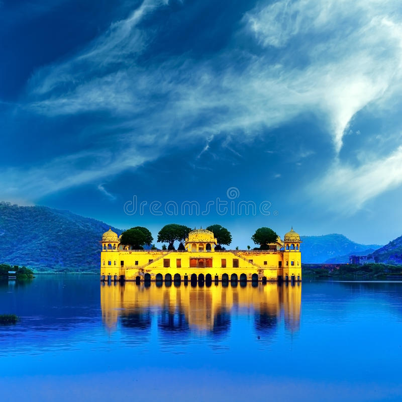 Indian water palace on Jal Mahal lake at night time in Jaipur. India royalty free stock photo