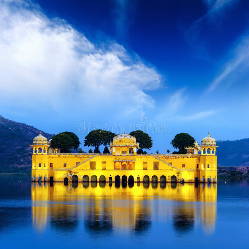 Indian water palace on Jal Mahal lake at night time in Jaipur. India royalty free stock image