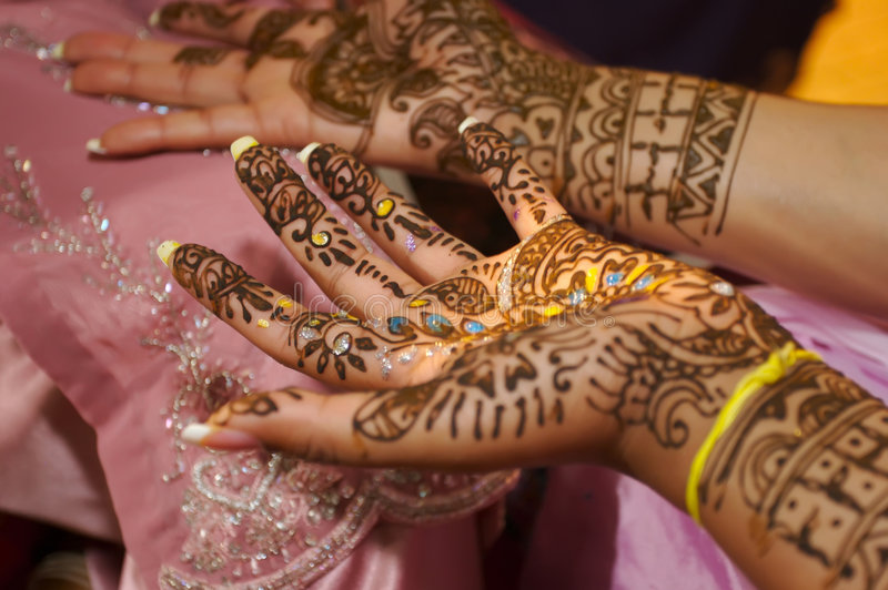 Indian wedding bride getting henna applied royalty free stock photography