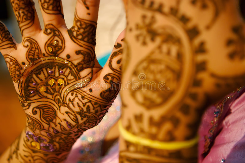 Indian wedding bride getting henna applied royalty free stock photos