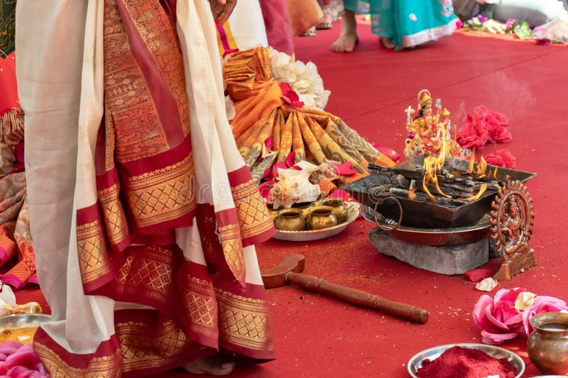 Indian wedding ceremony, decorations for traditional ethnic rituals for marriage, fire burning, flowers and statuettes of the. Deity on red carpet royalty free stock photography