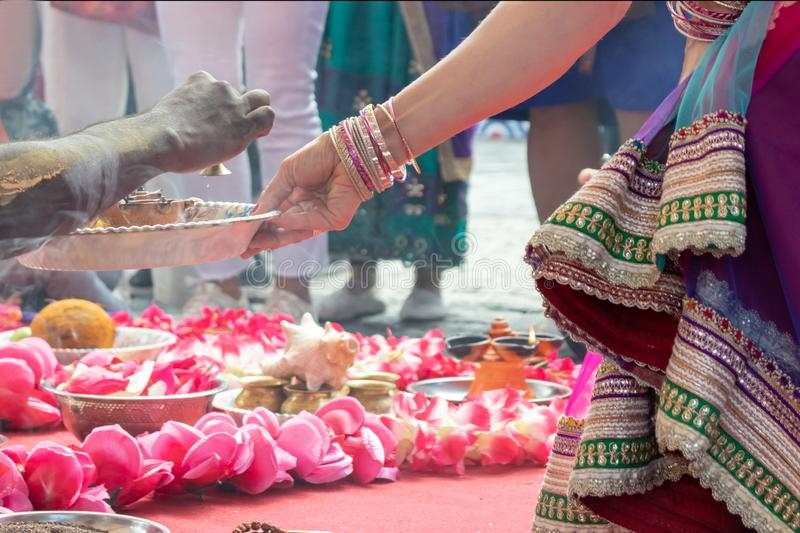 Indian wedding ceremony, decorations for traditional ethnic rituals for marriage, fire burning, flowers and statuettes of the. Deity on red carpet royalty free stock photo