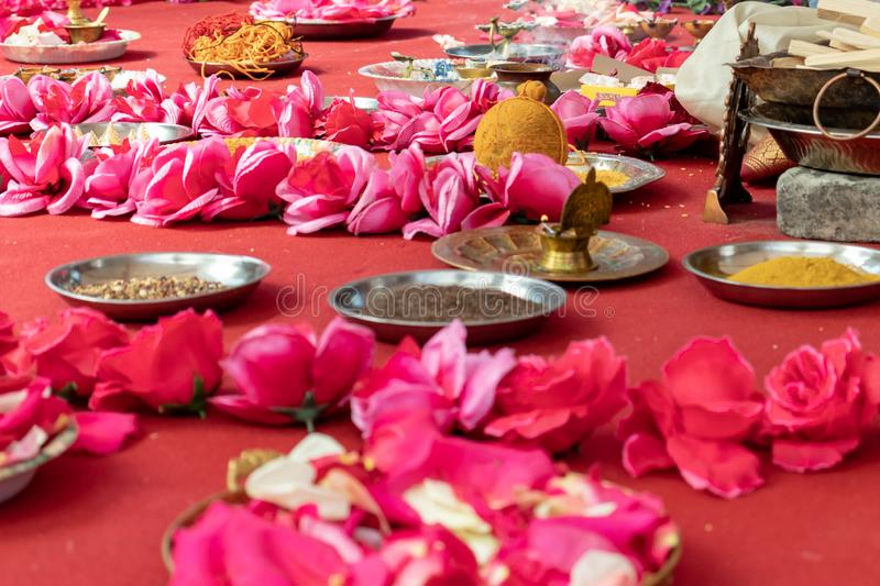 Indian wedding ceremony, decorations for traditional ethnic rituals for marriage, fire burning, flowers and statuettes of the. Deity on red carpet royalty free stock photos