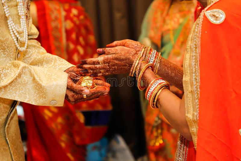 Indian wedding  photography ,groom and bride hands royalty free stock photos