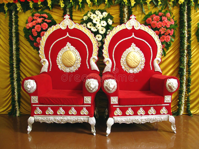 Indian Wedding Stage. Two traditionally decorated chairs on wedding stage royalty free stock images