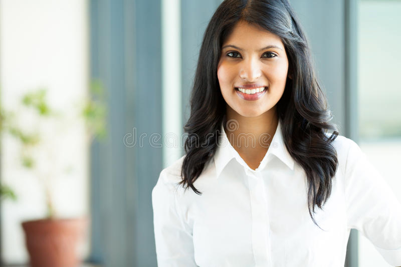 Indian white collar worker. Pretty young indian white collar worker in office stock images