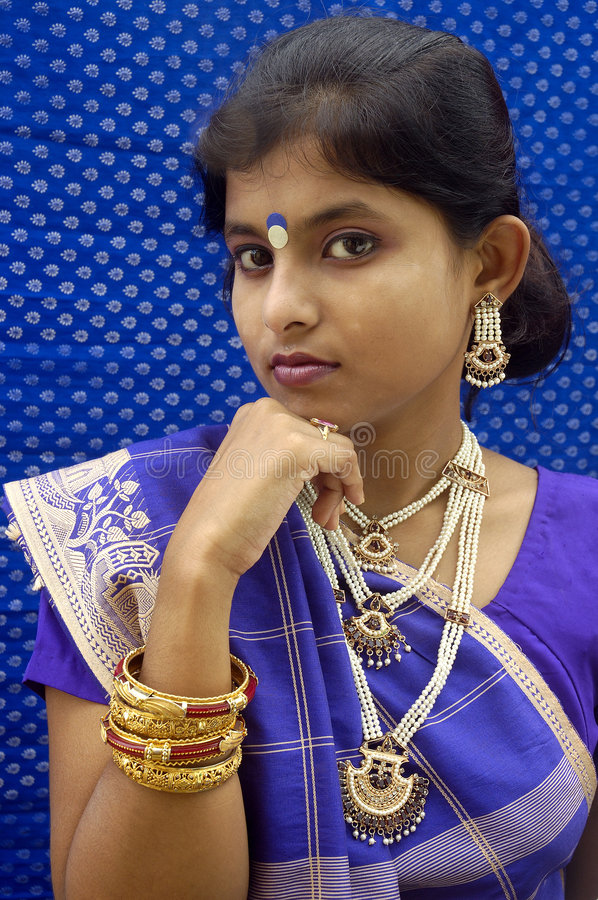 Indian woman. A view of a Indian woman wearing blue saree(Indian traditional dresses stock photography
