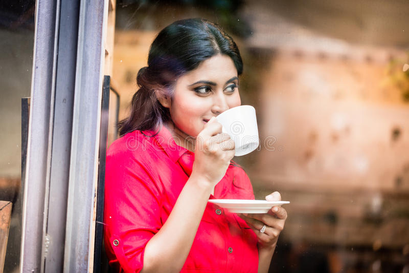 Indian woman with coffee mug royalty free stock images