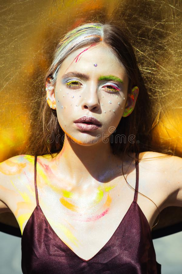 Indian woman with colorful makeup face, body art royalty free stock photo