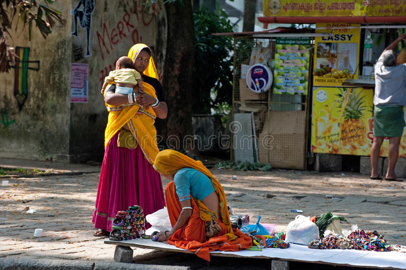 Indian woman in colorful sari sells souvenirs, bangles and cheap jewelry stock photography