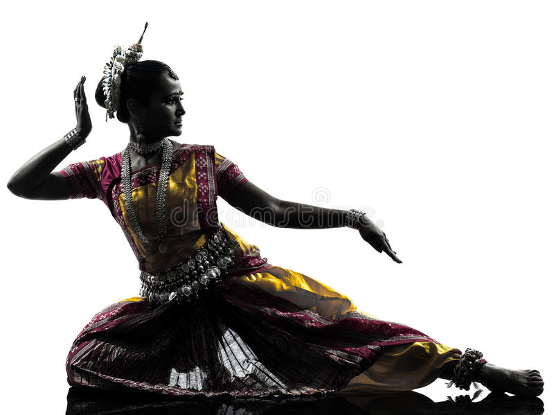Indian woman dancer dancing silhouette. One indian woman dancer dancing in silhouette studio on white background royalty free stock image