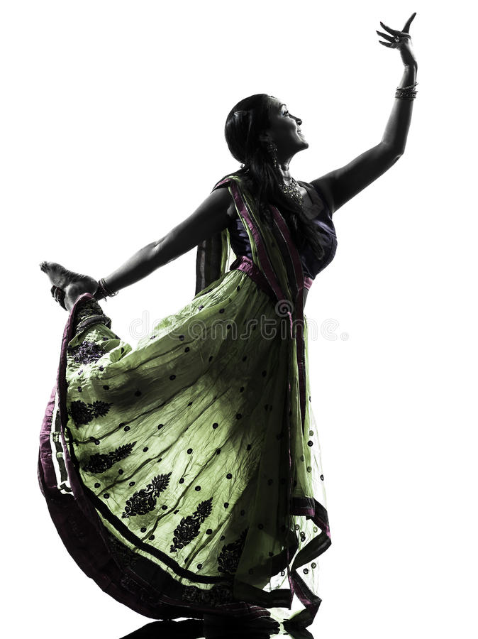 Indian woman dancer dancing silhouette. One indian woman dancer dancing in silhouette studio on white background stock images