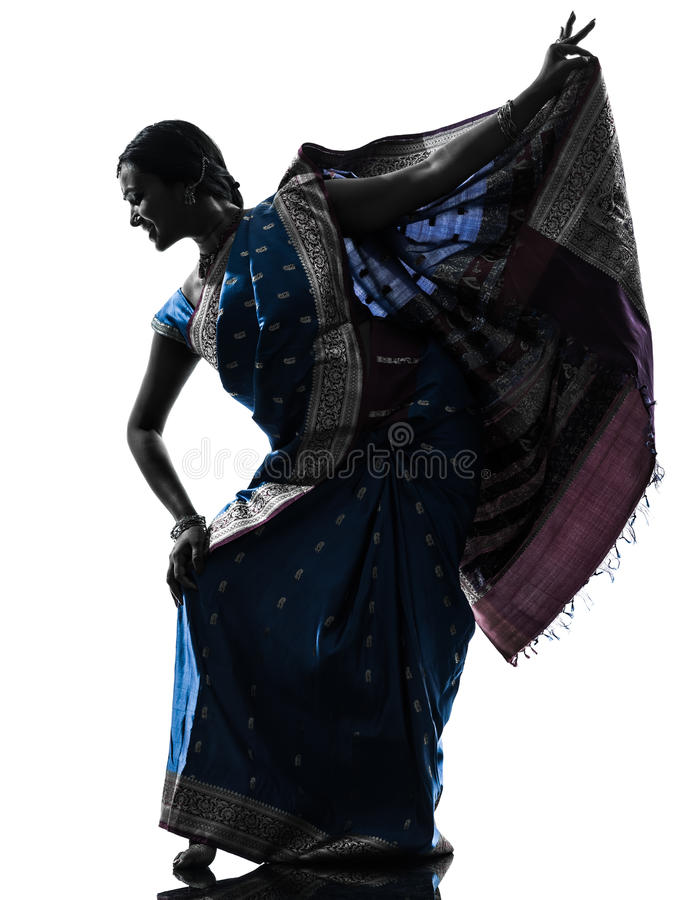 Indian woman dancer dancing silhouette. One indian woman dancer dancing in silhouette studio on white background royalty free stock photos
