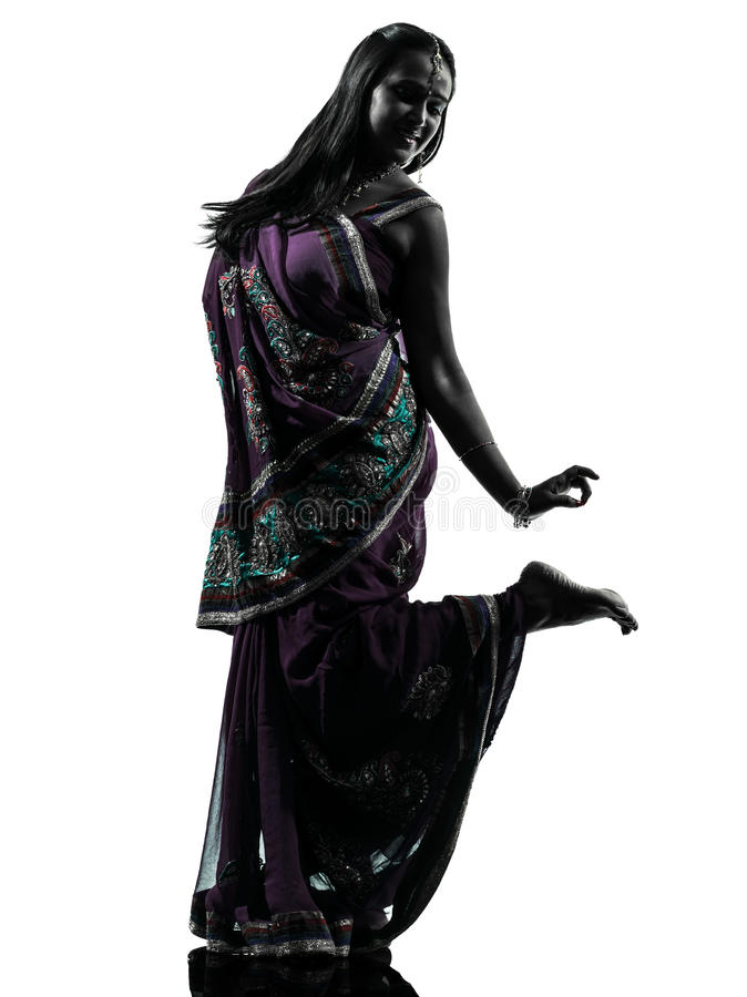 Indian woman dancer dancing silhouette. One indian woman dancer dancing in silhouette studio isolated on white background stock photography