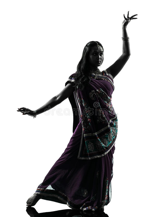 Indian woman dancer dancing silhouette. One indian woman dancer dancing in silhouette studio isolated on white background stock image