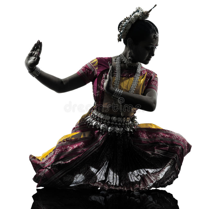 Indian woman dancer dancing silhouette. One indian woman dancer dancing in silhouette studio isolated on white background royalty free stock photo