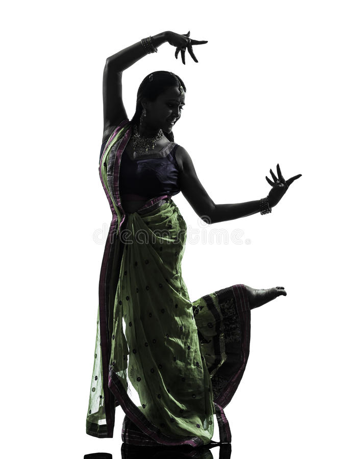 Indian woman dancer dancing silhouette. One indian woman dancer dancing in silhouette studio isolated on white background stock photo