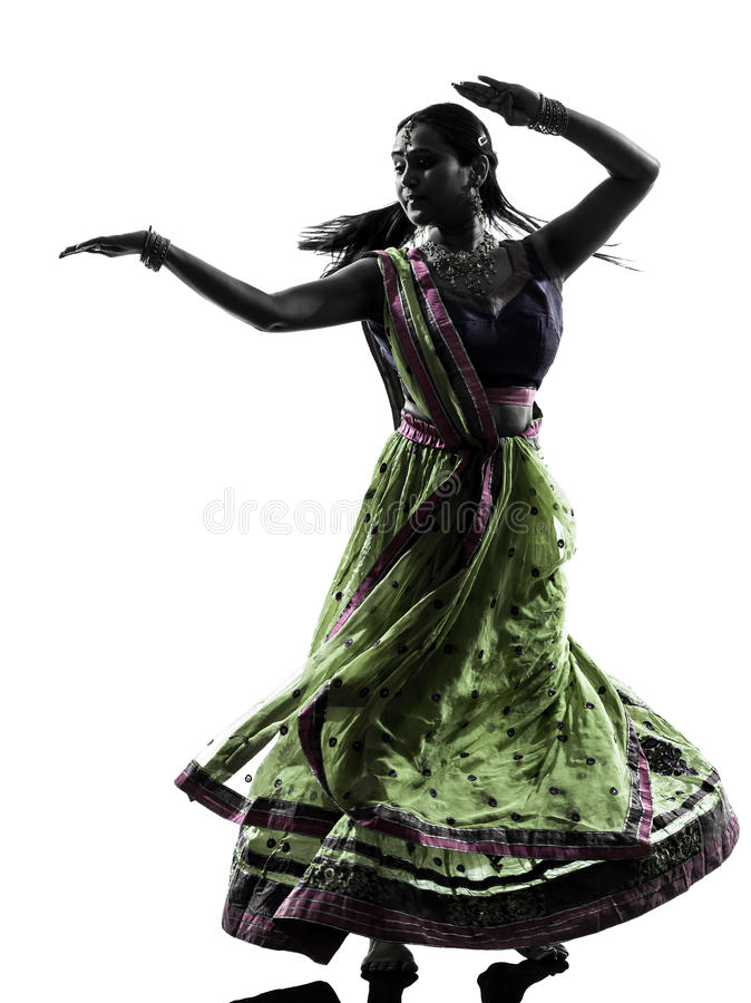 Indian woman dancer dancing silhouette. One indian woman dancer dancing in silhouette studio isolated on white background royalty free stock images