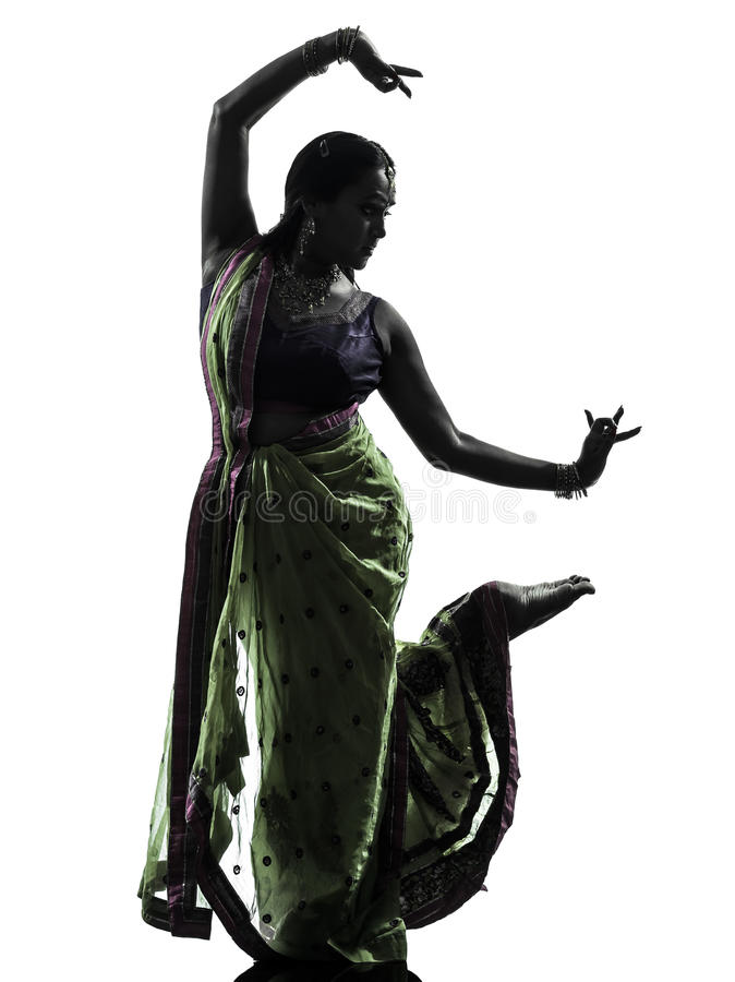 Indian woman dancer dancing silhouette. One indian woman dancer dancing in silhouette studio isolated on white background stock photos