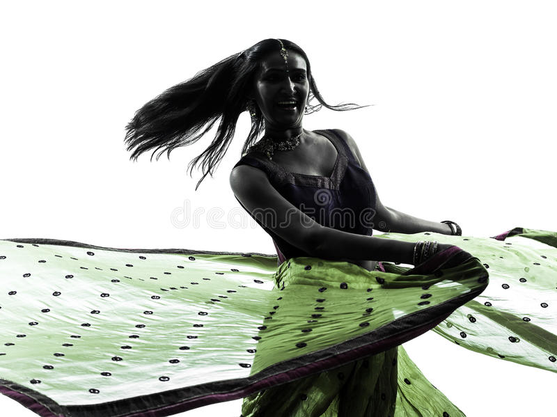 Indian woman dancer dancing silhouette. One indian woman dancer dancing in silhouette studio isolated on white background royalty free stock photography