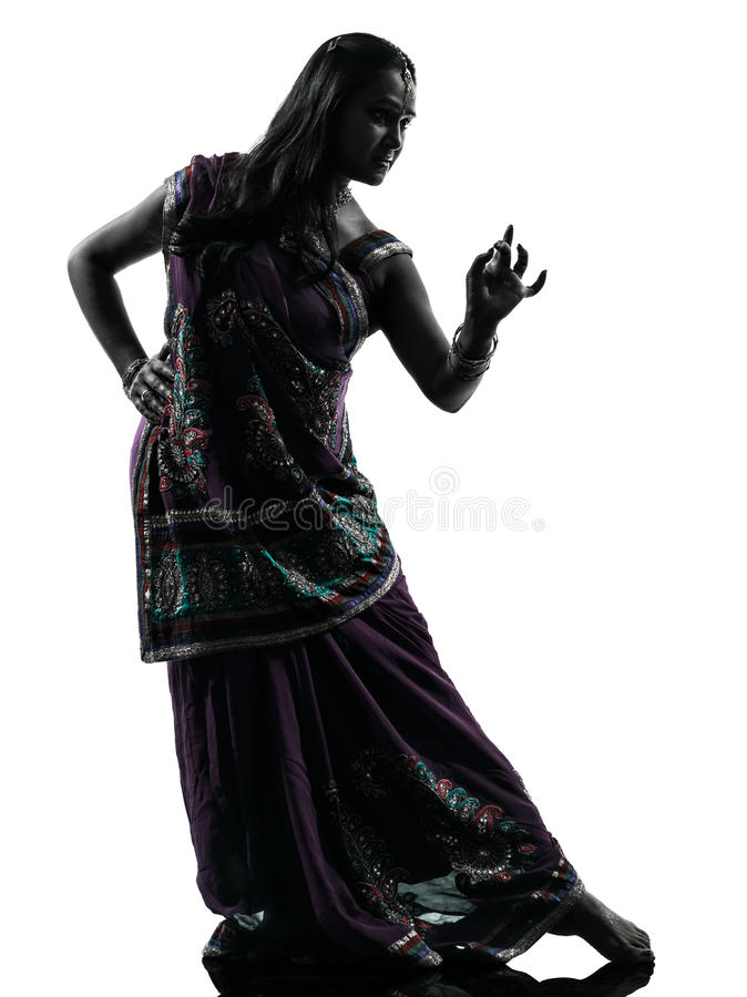 Indian woman dancer dancing silhouette. One indian woman dancer dancing in silhouette studio isolated on white background stock images