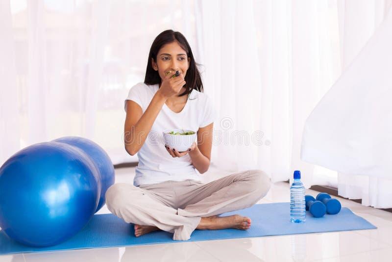 Indian woman eating salad royalty free stock image