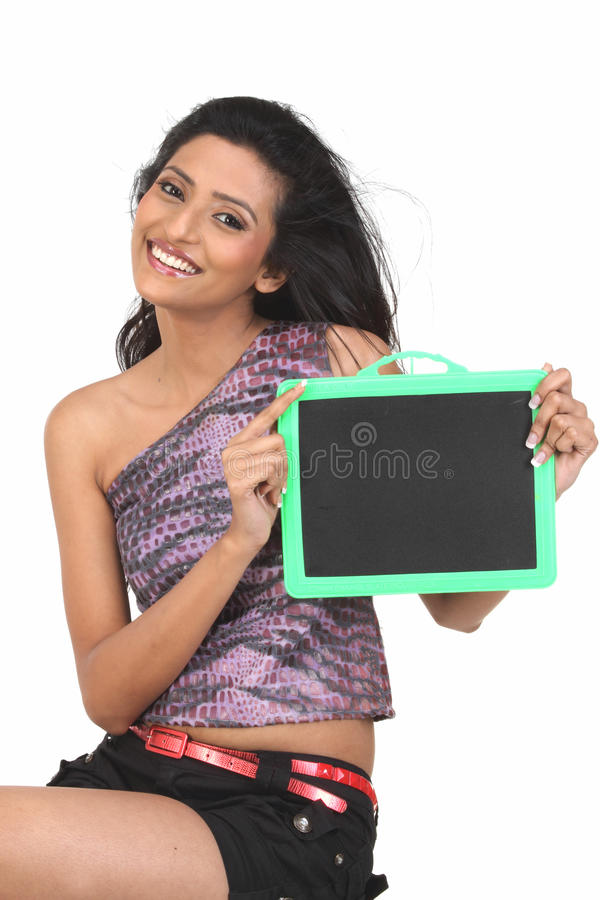 Indian woman holding an empty blackboard royalty free stock photography