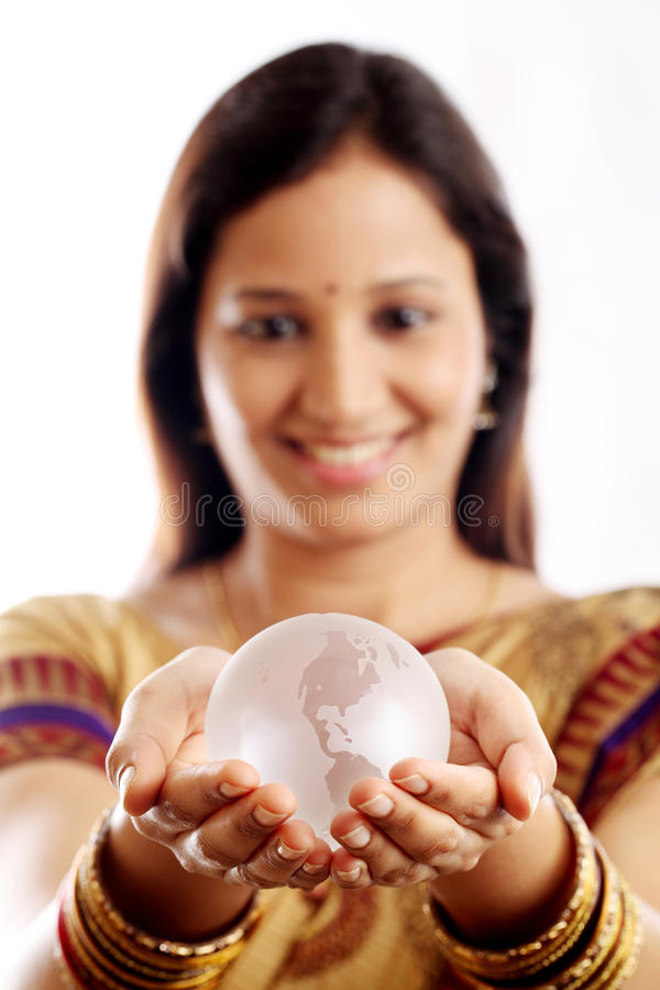 Indian woman holding a glass globe stock photos
