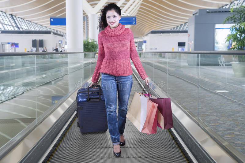 Indian woman with luggage and shopping bags royalty free stock images