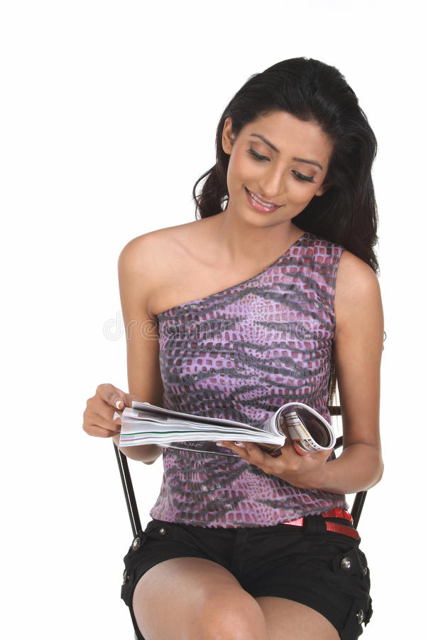 Download Indian woman with magazine stock photo. Image of indian - 12353954