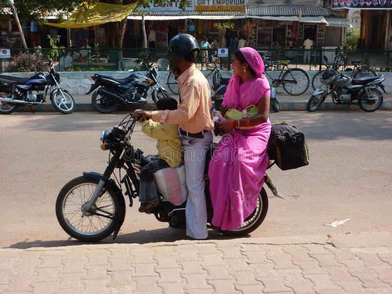 Indian woman in purple sari royalty free stock photo