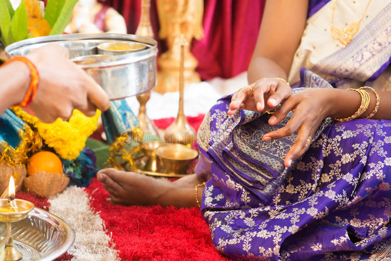 Indian woman received prayers from priest. royalty free stock photography