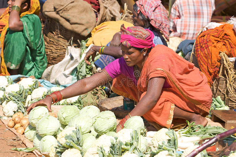 Indian woman in the rural area market stock images